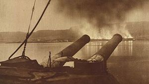 13th (Western) Division - View of Gallipoli from the battleship HMS Cornwallis. The smoke is coming from the British and Commonwealth stores being burned during the evacuation.