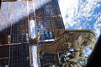 Extravehicular activity - Cosmonaut Sergey Volkov works outside the International Space Station on August 3, 2011.
