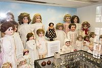 Wall of antique dolls (26908011722).jpg