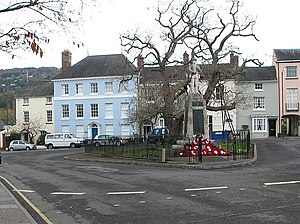 St James Square, Monmouth - Red remembrance poppies next to Monmouth War Memorial in the square, with the Dispensary (to the left) and Ebberley House (behind Catalpa)