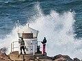 Waves hit the Cliffs near the small light house.jpg