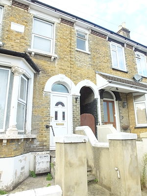 Byelaw terraced house - Two larger 1886 houses in Kent, separated by a ginnel, they have cellars. They have cast stone lintels but have lost the sash windows and the ogee guttering