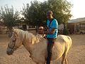 Wikipedian Mompati Dikunwane riding on a horse in Otjinene.jpg
