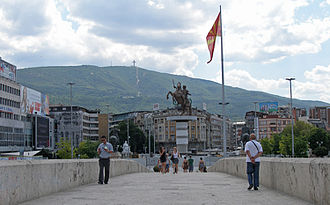 Skopje 2014 - View toward Macedonia Square from the Stone Bridge in July 2011. Visible are the statues of Dame Gruev, Goce Delčev, Tsar Samuil, and the under construction Warrior on a Horse monument