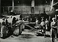 Women inserting and packing tubes in condensors for marine engines (15216231140).jpg