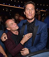 A photograph of Woody Harrelson and Matthew McConaughey at the 66th Primetime Emmy Awards
