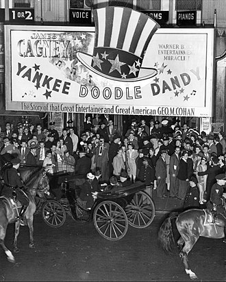 Yankee Doodle Dandy - Premiere at New York's Hollywood Theatre on May 29, 1942.  Tickets were available only to those who bought War Bonds.  Former New York governor Al Smith and his wife are in the horse-drawn carriage.