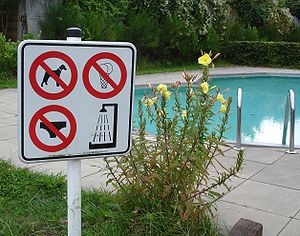 Naturism - Sign at a naturist swimming pool with a warning that no clothing (including underwear) is permitted.