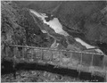 """Roosevelt Dam. View of south spillway showing progress of concrete removal and chipping of piers."" - NARA - 294615.tif"