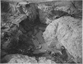 """""""The completed frozen arch with a full view of the crevice cleaned out to bedrock. Average bottom of pit is at elev.... - NARA - 294343.tif"""