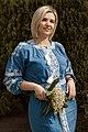День Вишиванки. Молода україночка у вишитій синій сукні серед квітів 27.jpg