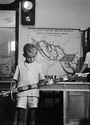 Sword of Stalingrad - A boy inspects the Sword of Stalingrad in the Battle of Stalingrad Museum, 1953