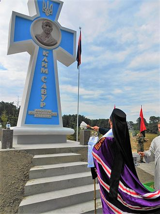 Dmytro Klyachkivsky - Monument to Dmytro Klyachkivsky as Klym Savur at his place of death near Orzhiv, sprinkled with holy water by a Ukrainian Orthodox priest