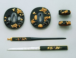 Japanese sword mountings Housings and associated fittings that hold the blade of a Japanese sword