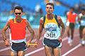 141100 - Athletics track Gerrard Gosens guide action - 3b - 2000 Sydney race photo.jpg