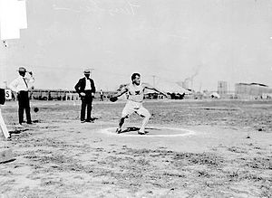 Athletics at the 1904 Summer Olympics – Men's discus throw - John Flanagan throwing the discus on the way to finishing in fourth place.