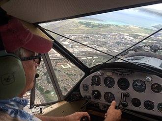 Bellanca CH-300 Pacemaker - Hawaiian Airlines restored their first Bellanca, NC-251M, seen flying over Honolulu International Airport