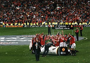1998–99 Manchester United F.C. season - The team celebrate winning the FA Premier League title after their victory over Tottenham on 16 May 1999.
