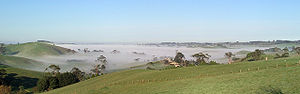 Hills of South Gippsland in Victoria, Australia, partly shrouded in morning mist (un-cropped)