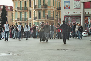 "2006 youth protests in France - In Cannes, on 31 March, a few hundred youths blocked the important junction ""Place du 18 juin"" for 10 to 15 minutes."