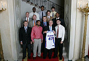 Members of the 2007 men's basketball champions pose with Bush for the second time in as many years.
