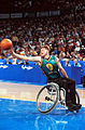 201000 - Wheelchair basketball David Gould reaches - 3b - 2000 Sydney match photo.jpg