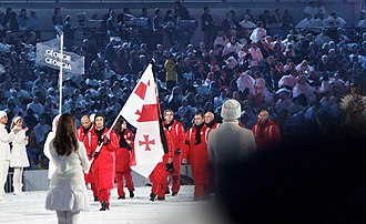 2010 Winter Olympics national flag bearers - The Georgian flag being carried by Iason Abramashvili. In this picture the flag has a black ribbon.