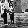 25 April 2018 - Celebrating the 1974 Carnation Revolution - Two tourists women slightly amazed with the demonstration (42709703615).jpg