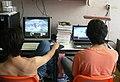 2 men using their computers.jpg