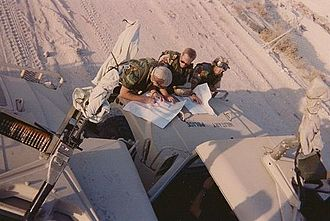 372nd Military Police Company (United States) - Three team leaders from the 372nd MP Company check their maps to coordinate patrol areas along convoy routes outside of Dammam, Saudi Arabia November 1990.