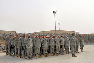 387th Air Expeditionary Group - Formation of Airmen deployed to the 387th Air Expeditionary Group lead the 386th Air Expeditionary Wing as they render a salute during a Memorial Day ceremony 26 May 2008 at an air base in the Persian Gulf Region. During the ceremony, a 21-gun salute was conducted along with a laying of a wreath to honor the men and women who have died in military service.