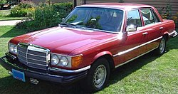 Older red four-door sedan