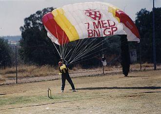 7 Medical Battalion Group - 7 Med Operator lands after freefall demonstration jump