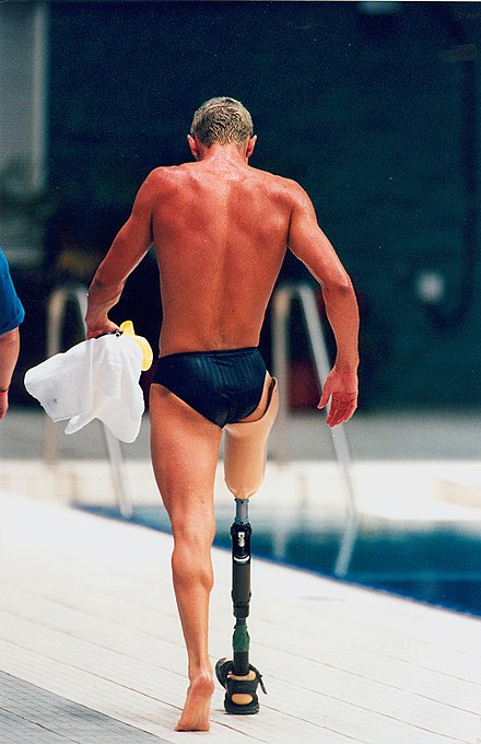 A man with a lower-extremity prosthesis 86 ACPS Atlanta 1996 Swimming General Views.jpg