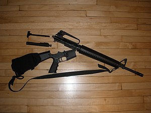 DPMS Panther Arms - DPMS AR-15 type rifle with open receivers showing charging handle and bolt carrier assembly