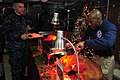 A Chief serves Christmas dinner to Sailors aboard USS George Washington. (11565943203).jpg