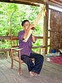A Mangkong man plays khene in Laos.jpg
