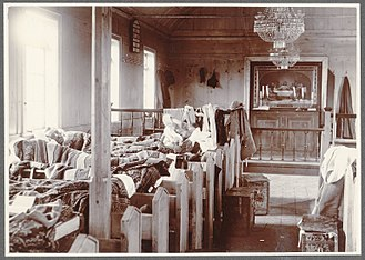 Camping in churches - People camping in a church at Hruni in Iceland around 1900