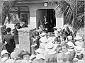 A crowd gathered outside a Plunket room (AM 80052-1).jpg