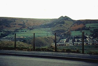 S. O. Davies - The spoil tips above Aberfan, photographed two years after the disaster