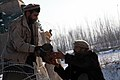 Afghan commandos hand off an improvised explosive device during a presence patrol in Pul-e Khumri district, Baghlan province, Afghanistan, Feb 120208-A-BT925-009.jpg