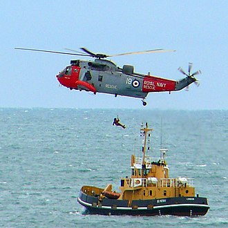 Air-sea rescue - A Royal Navy rescue helicopter in action above a boat