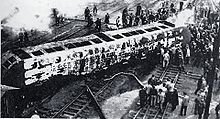 black and white image of a burned rail car on its side