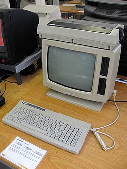 Image shows an early desk top computer with separate keyboard and small printer.