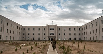 An Afghan National Defense University (ANDU) instructor exits an academic hall at the school in Kabul, Afghanistan, May 7, 2013 130507-F-OF869-007.jpg
