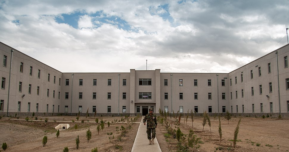 An Afghan National Defense University (ANDU) instructor exits an academic hall at the school in Kabul, Afghanistan, May 7, 2013 130507-F-OF869-007