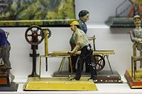 Antique toy factory workers (24633602503).jpg