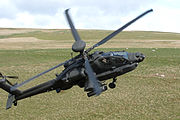 Photograph of an AgustaWestland Apache of 656 Squadron flying low over grassy land