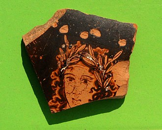 Pistiros - Face of Apollo or Dionysus depicted on a red-figure pottery fragment found in Pistiros (2015).