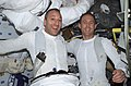 Astronauts James H. Newman and Michael J. Massimino Post-EVA (27947785491).jpg